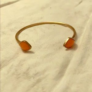 Gold bracelet with orange stones